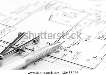 Drawing compass and pencil on house floor plan - stock photo