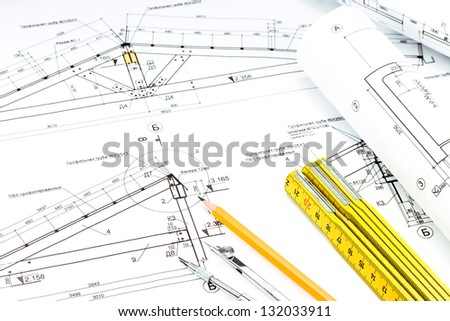 Drawing compass , pencil, and ruler on blueprint