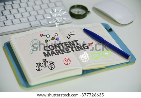 drawing CONTENT MARKETING concept on notebook in the office , business concept , business idea