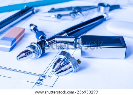 Drawing desk with tools for drawing. Angle view, in blue tone - stock photo