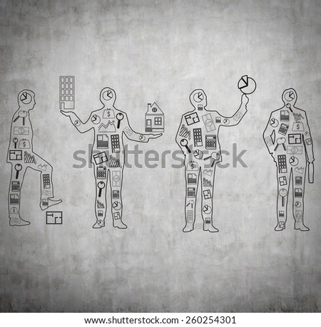 drawing four  businessman with business icons on wall - stock photo