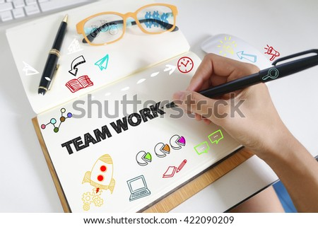 drawing icon cartoon with TEAM WORK  concept on paper in the office , business concept , business idea , strategy concept - stock photo