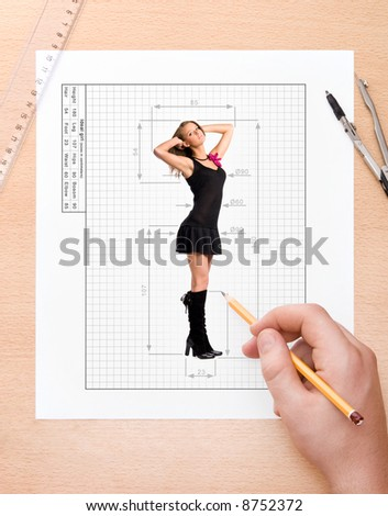 Drawing ideal girl. Concept image with male hand writing sizes of ideal girl. - stock photo