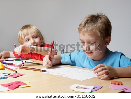 Drawing lesson in an elementary school - stock photo