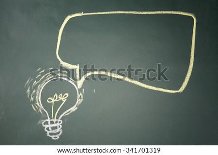 drawing- light bulb on blackboard with speech bubble - stock photo