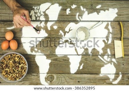 Drawing maps of the world with flour Beautiful backdrop of the flour in the form of a map of the world - stock photo