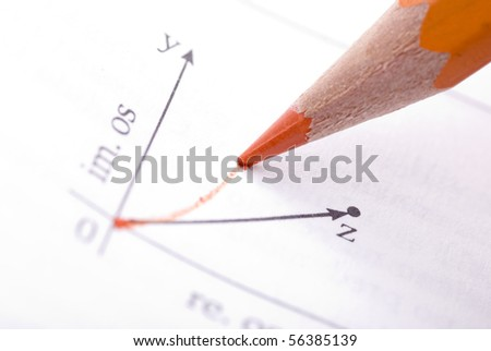 Drawing math graph with orange color pencil - stock photo