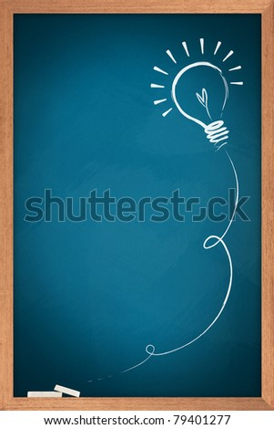 Drawing of a bulb idea on blue board - stock photo