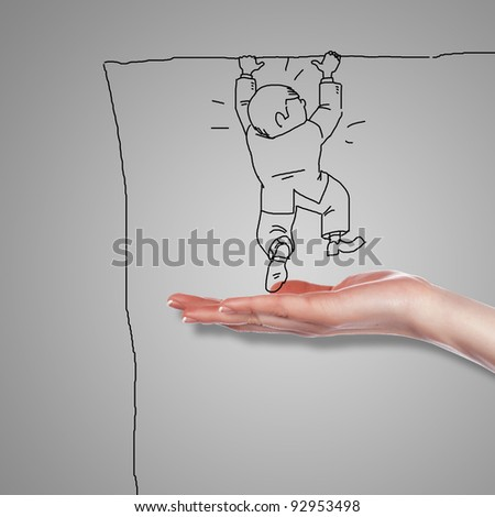 Drawing of a human hand supporting a person - stock photo