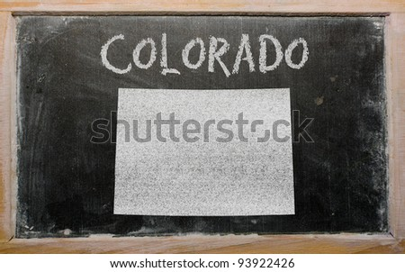 drawing of american state of colorado on chalkboard, drawn by chalk - stock photo