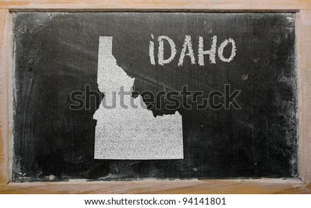drawing of american state of idaho on chalkboard, drawn by chalk - stock photo