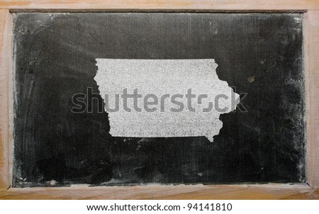 drawing of american state of iowa on chalkboard, drawn by chalk - stock photo