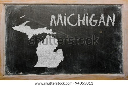 drawing of american state of michigan on chalkboard, drawn by chalk - stock photo
