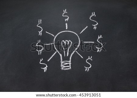 Drawing of idea and money on the blackboard - stock photo