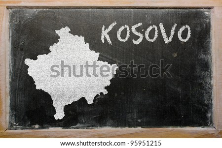drawing of kosovo on chalkboard, drawn by chalk - stock photo