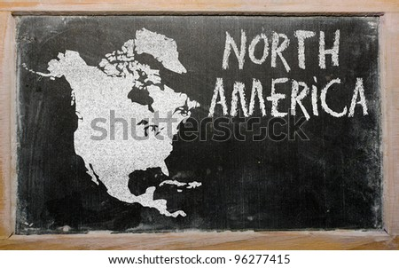 drawing of north america on blackboard, drawn by chalk - stock photo