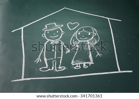 drawing on the chalkboard husband and wife in love protected in a house - stock photo