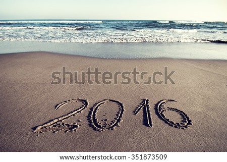 Drawing 2016 on the sand - stock photo