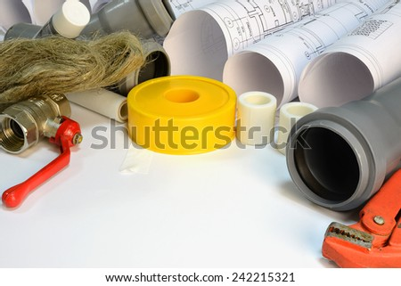 Drawing rolls, gas wrench, pipe joints, Y fitting, ball valve, drain pipe, plumber's tape, sealing paste, sanitary tow - stock photo