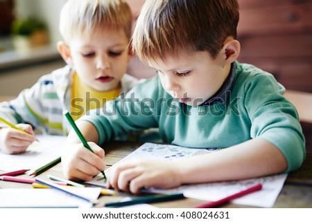 Drawing siblings - stock photo