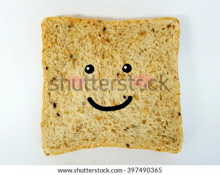 Drawing the smiley face on bread slice. isolated bread on white background. Happy breakfast Concept. - stock photo