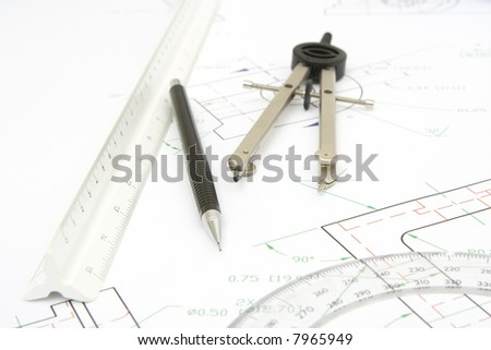 drawing tools with a technical print background - stock photo