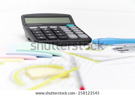 Drawing tools with compass and calculator - stock photo
