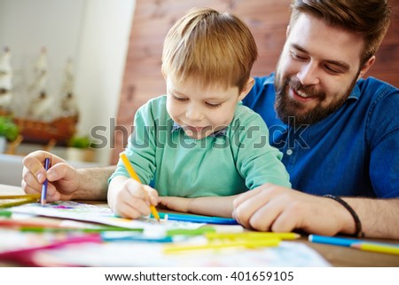Drawing with father - stock photo