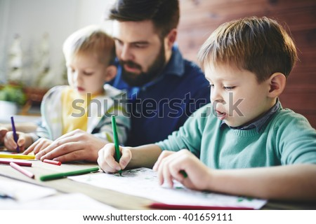 Drawing with sons - stock photo