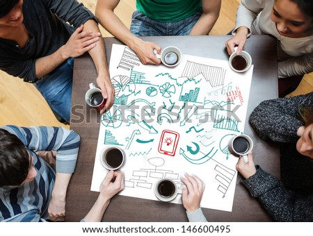 Drawings of charts and arrows drew on a poster during a brainstorm - stock photo