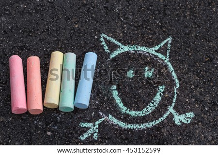 drawings on pavement. children's drawings with crayons on the pavement - stock photo