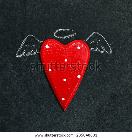 drawn angel on chalk board - stock photo