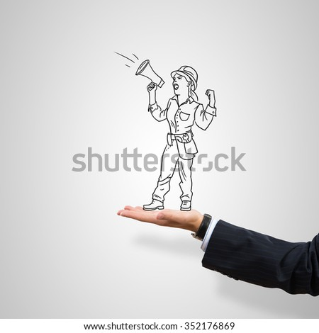 Drawn engineer woman in female palm on gray background