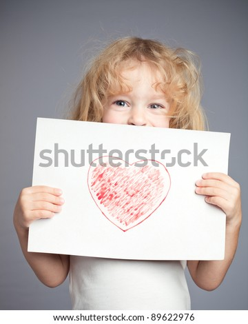 Drawn heart in baby hands. Valentine`s day concept - stock photo