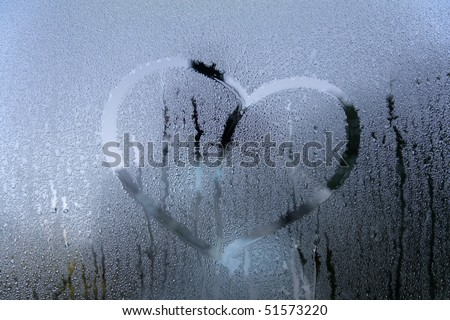 drawn heart on the wet glass - stock photo