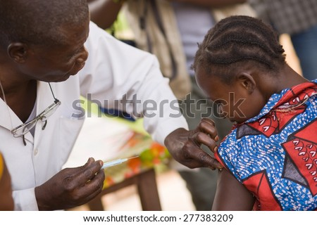 DRC, Democratic Republic of Congo. UNICEF mission against tetanus in September 2008. Doctor from UNICEF mission doing the tetanus vaccination. - stock photo