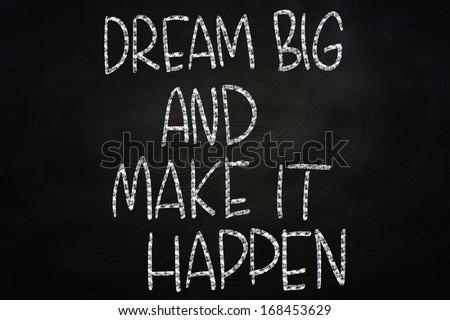 Dream Big and Make It Happen, Motivational Phrase Written on Blackboard - stock photo