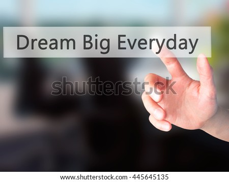 Dream Big Everyday - Hand pressing a button on blurred background concept . Business, technology, internet concept. Stock Photo - stock photo