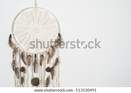 Dream catcher with brown feathers in the interior. DIY Home Decor Concept, space for text