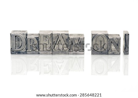 dream on exclamation made from metallic letterpress type on reflective surface