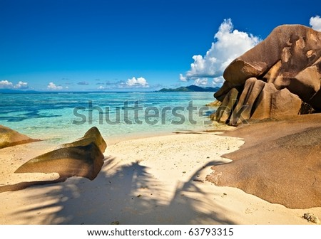 Dream seascape view with a big stones and palm tree, Seychelles, La Digue island