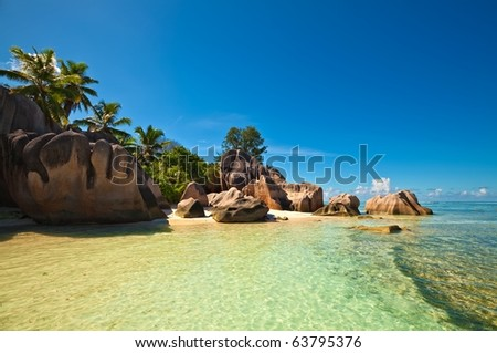 Dream seascape view with a big stones and palm tree, Seychelles, La Digue island - stock photo