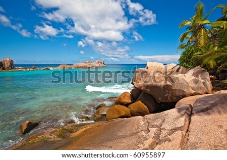 Dream seascape view with a big stones and palmtree, Seychelles, La Digue island - stock photo