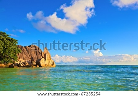 Dream sunset seascape view with a big stones and palmtree, Seychelles, La Digue island - stock photo