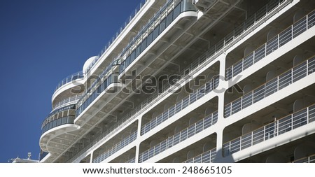 Dream vacation: cruise ship on blue sky background - stock photo