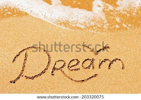 Dream written in the sand  - stock photo
