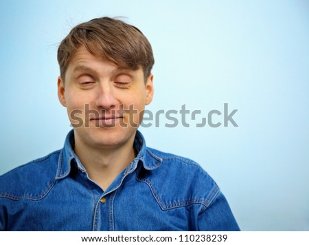 Dreaming a man with a satisfied look on his face - stock photo