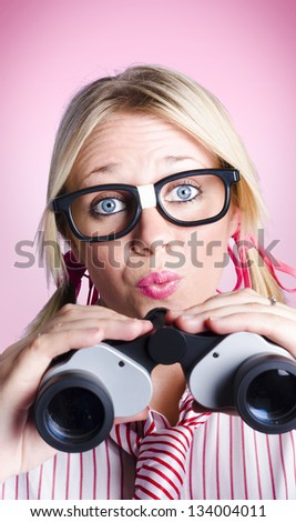 Dreaming businesswoman lost in thought holding binoculars in a seek to find concept