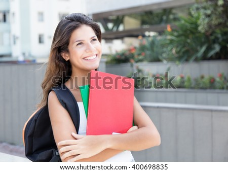 Dreaming caucasian female student in the city - stock photo