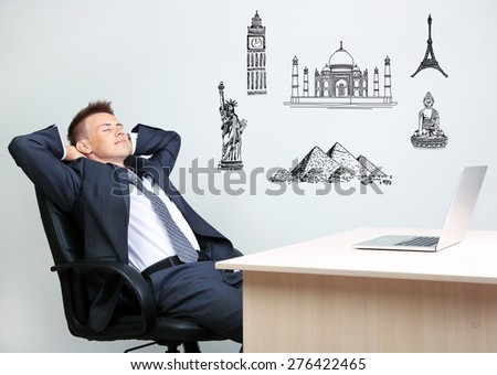 Dreaming concept. Portrait of young businessman in office - stock photo